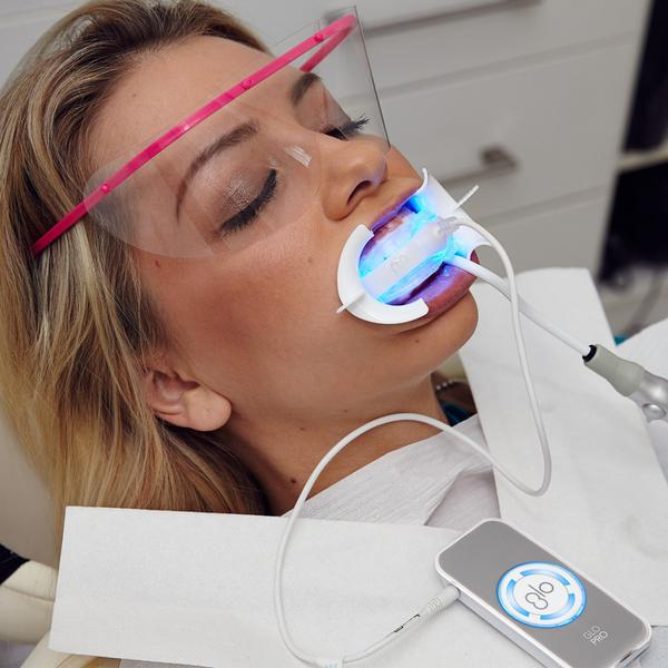 A dental patient receiving an in office professional teeth whitening treatment in Poway, CA