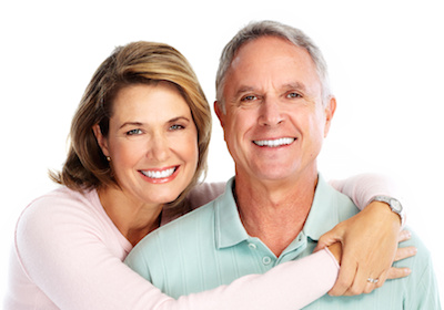 A mature couple smiling because of dental implants in Poway CA