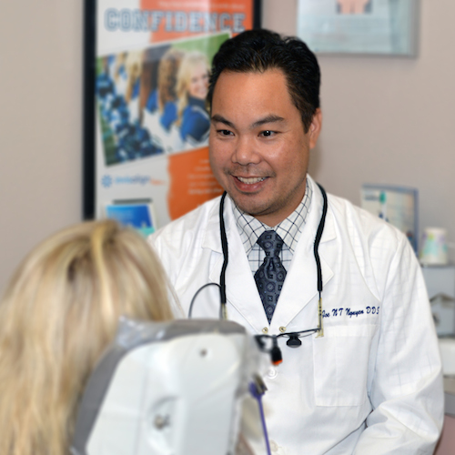 Dr. Joe N.T. Nguyen talking to an actual patient to show that the client is in control at this cosmetic dentist in Poway, CA